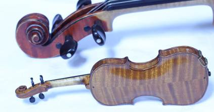 Miniature violin in case